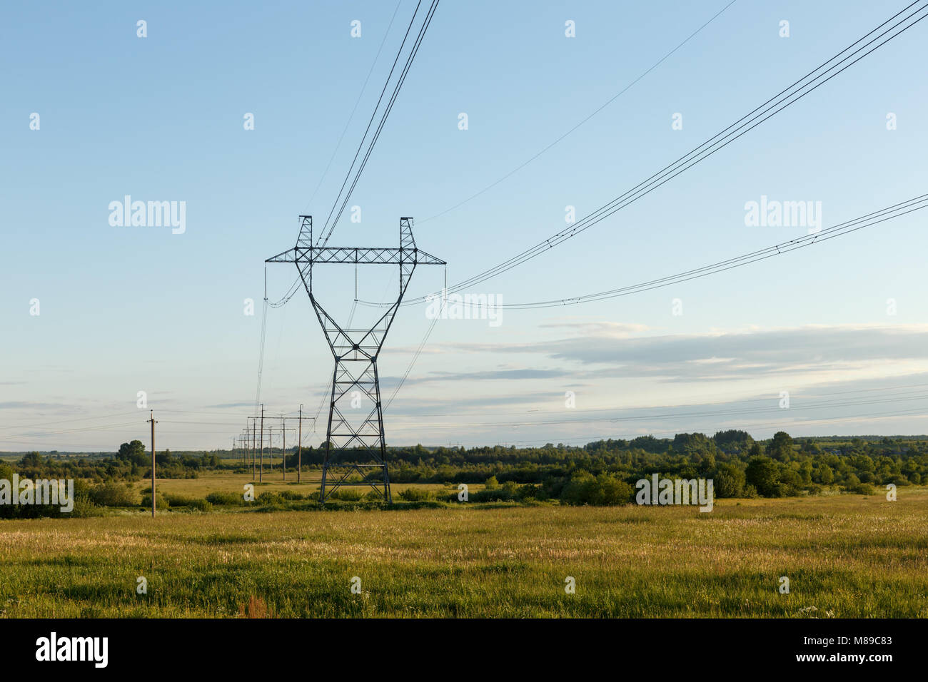 support of high-voltage power line in the field. - Stock Image