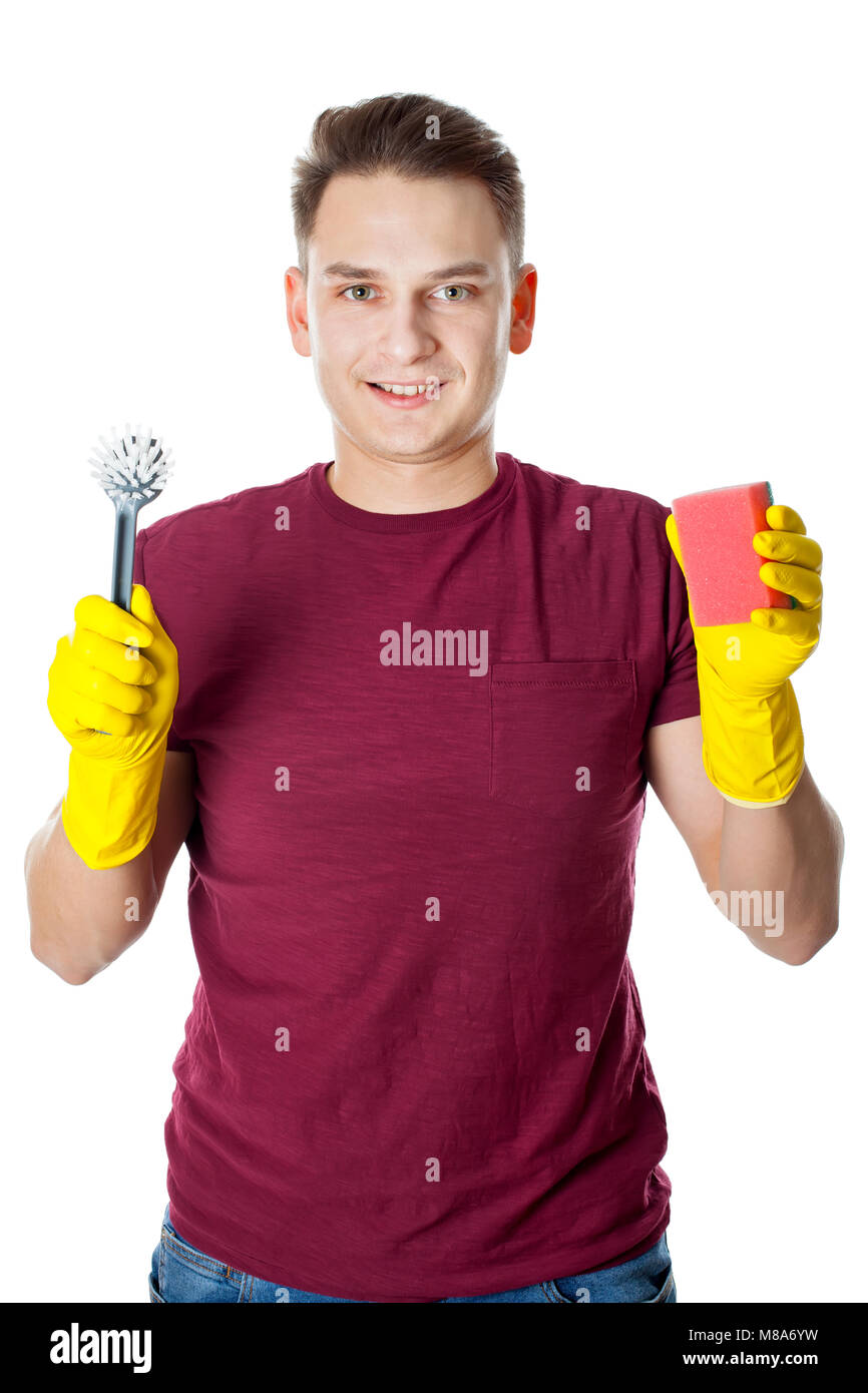 Young man wearing yellow gloves and holding cleaning supplies, housekeeper Stock Photo