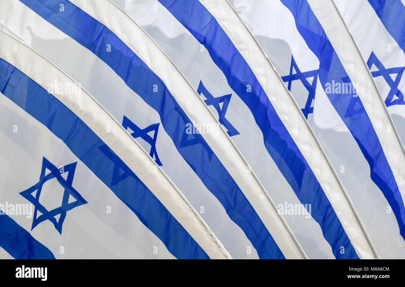 Set of five Israeli flags blowing in the wind - Stock Image