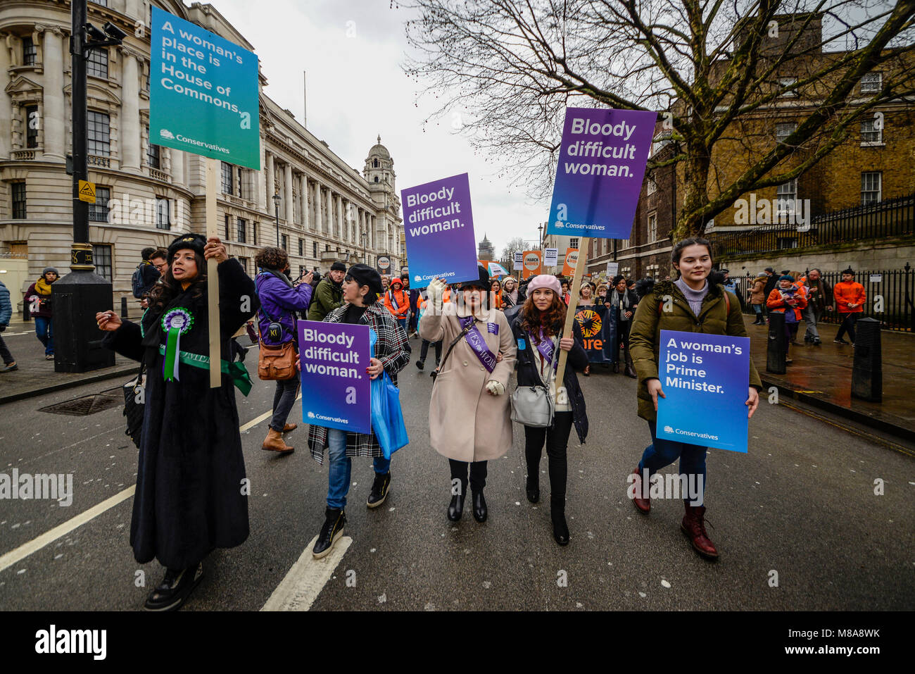 Protesters marching with Conservative placards in Whitehall at the March 4 Women women's equality protest organised - Stock Image