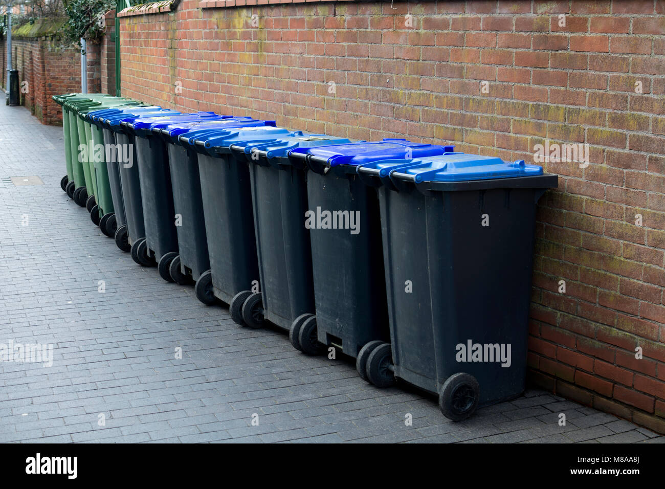 A row of domestic waste bins in a street, Stratford-upon-Avon, UK - Stock Image