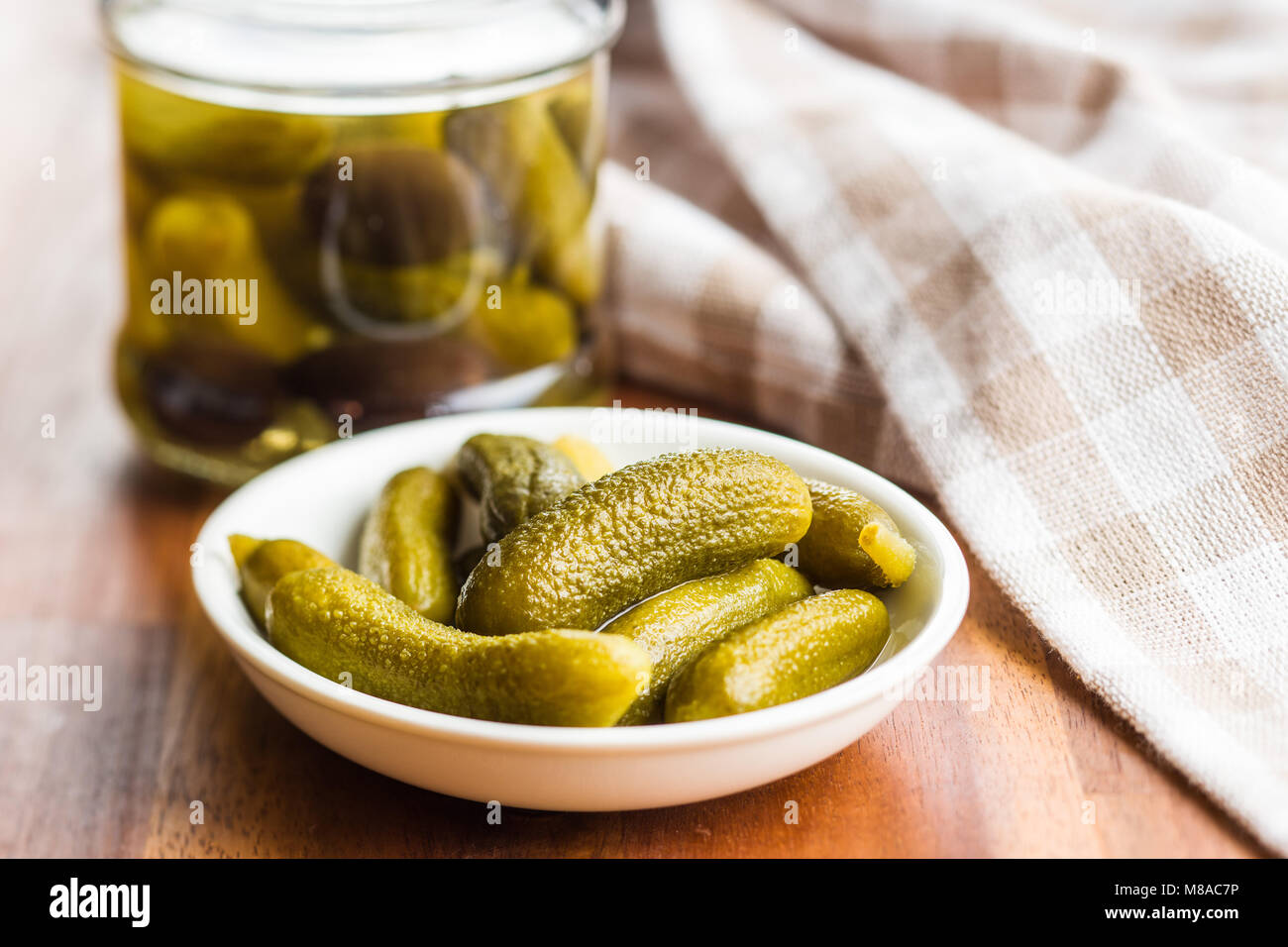 Pickles. Preserved cucumbers in bowl. - Stock Image