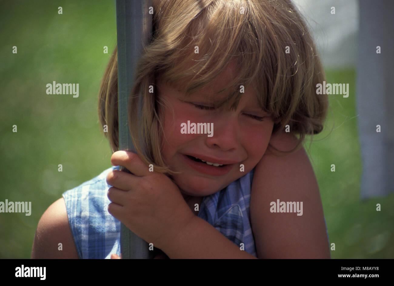Little girl in playground having a tantrum - Stock Image