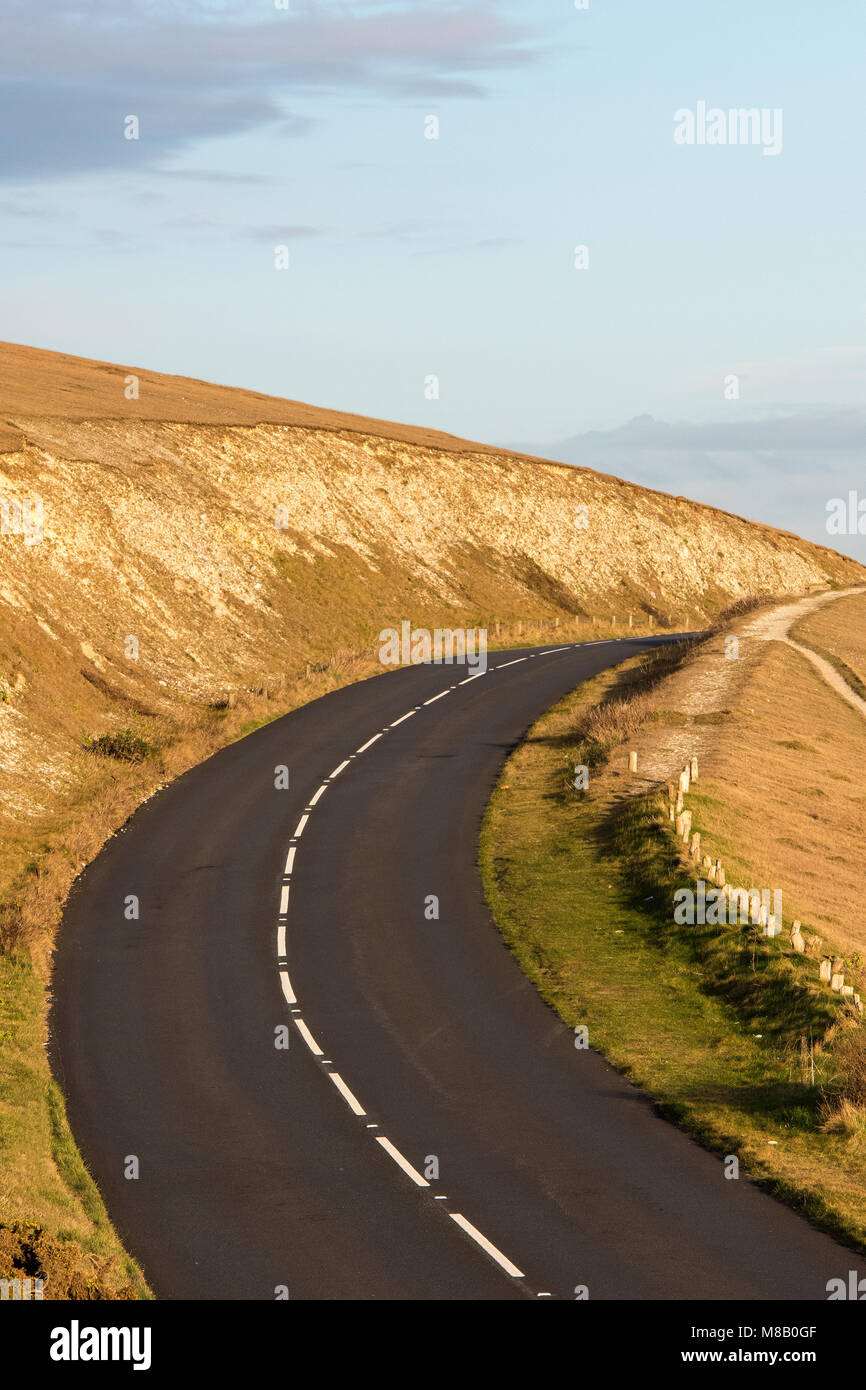 A road running through the hills or mountains empty and disappearing into the distance or over the horizon. Travelling - Stock Image