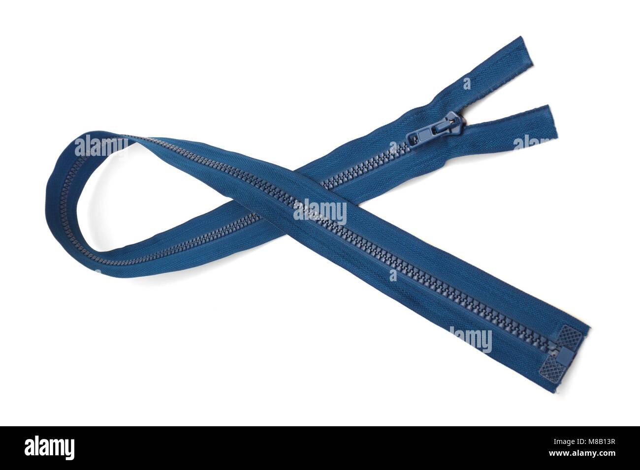 Blue long zipper closeup isolated on white background - Stock Image