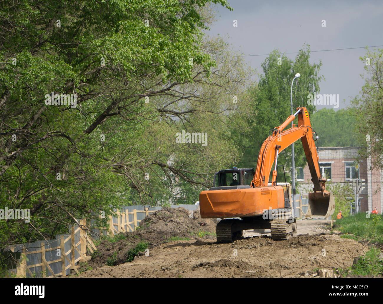 Excavators digging the ground - Stock Image
