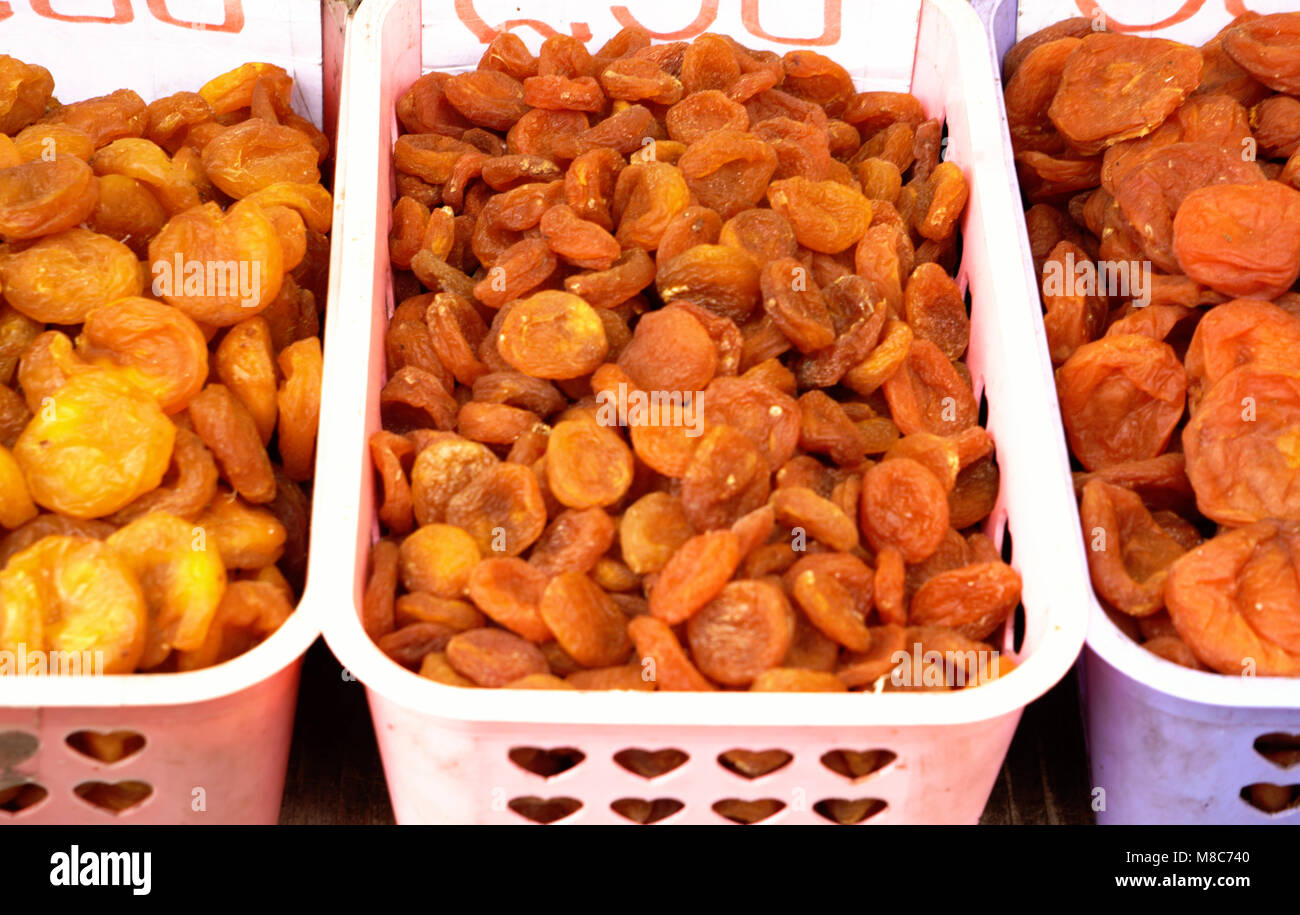 Dried apricot fruit forming a background. - Stock Image
