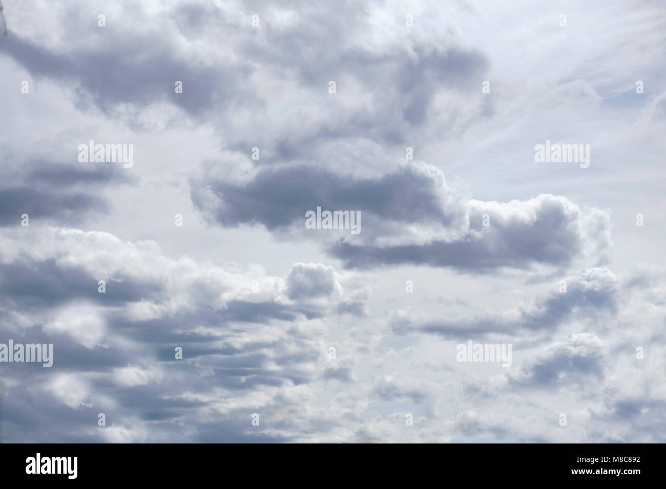 the clouds part in the sky - Stock Image