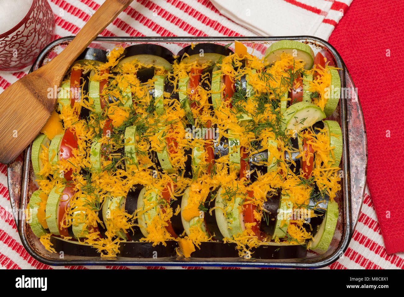 Vegetarian ratatouille made from beautiful, colored vegetables with the addition of Cheder cheese ready for baking. - Stock Image