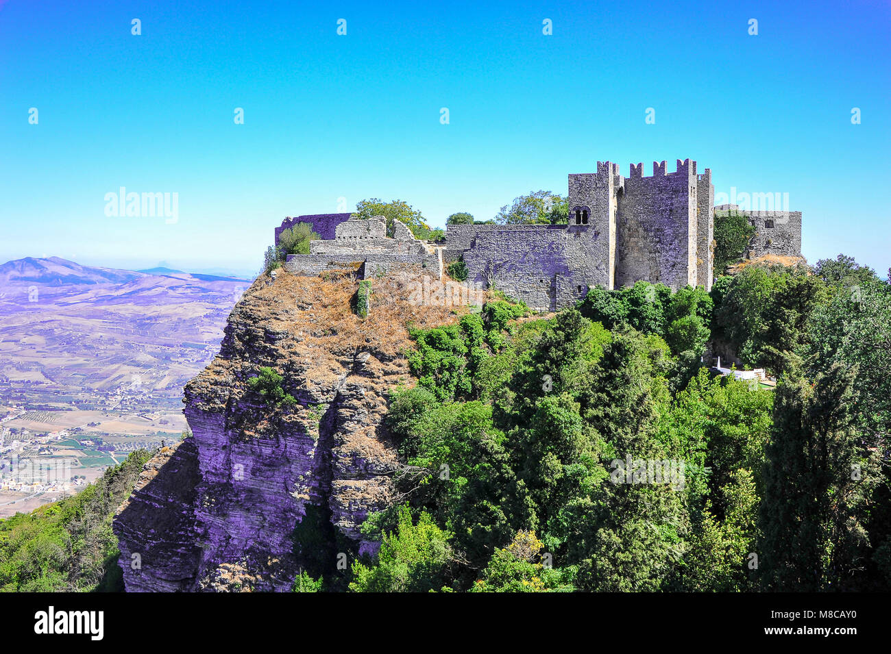Castello di Venere (Castle of Venus), perches on top Mount Erice, Sicily. Ancient Norman ruins on a green mountainside - Stock Image