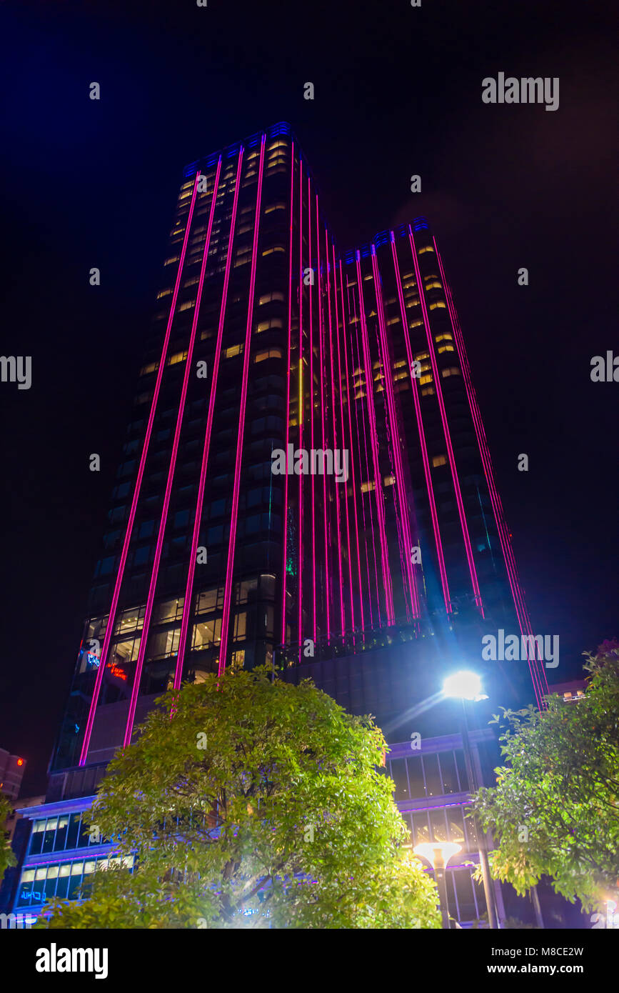 Saigon Times Square skyscraper, a 40-storey tower is illuminated with red strip lignts LEDs,  Ho Chi Minh City, - Stock Image