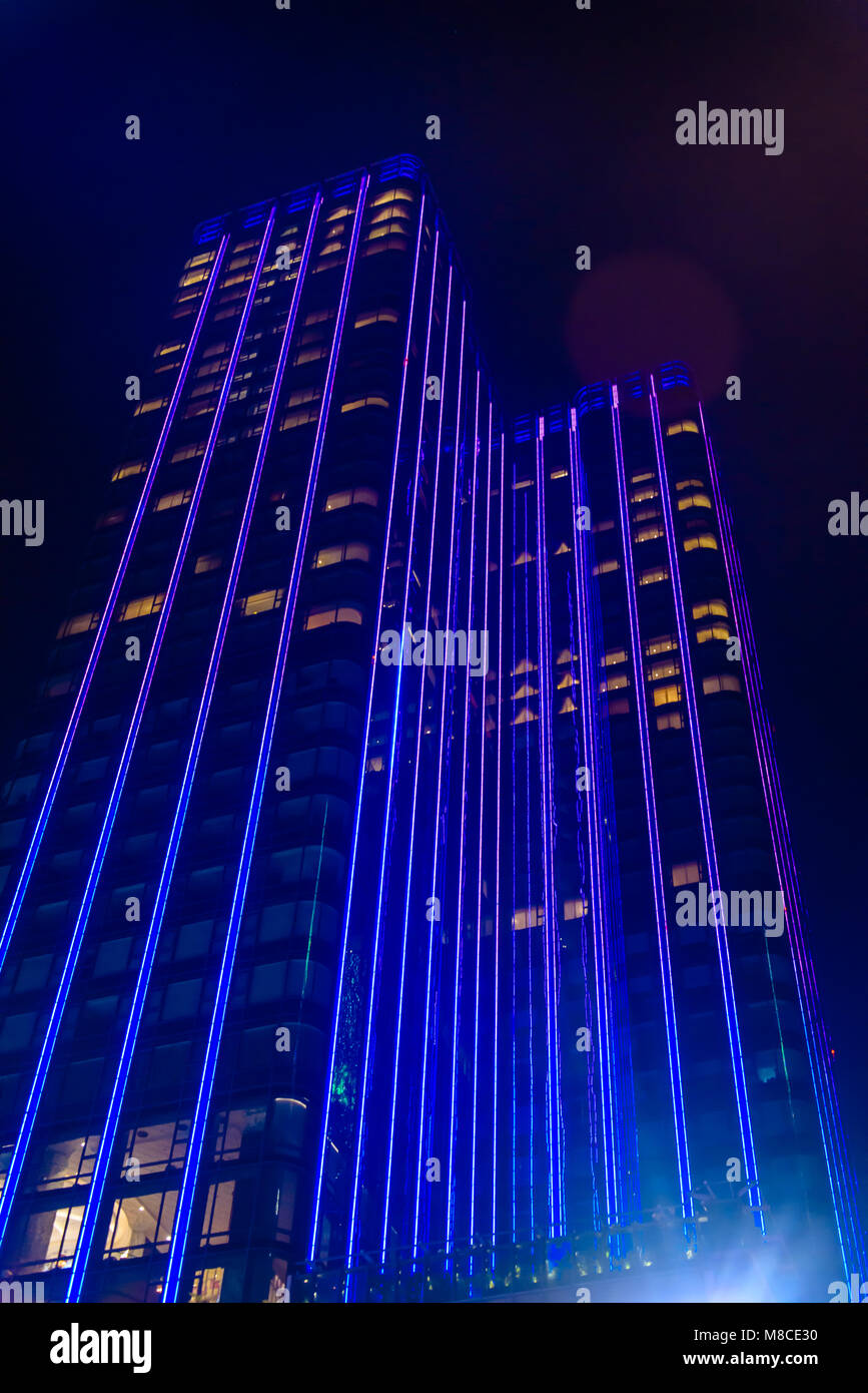 Saigon Times Square skyscraper, a 40-storey tower is illuminated with blue purple strip lignts LEDs,  Ho Chi Minh - Stock Image