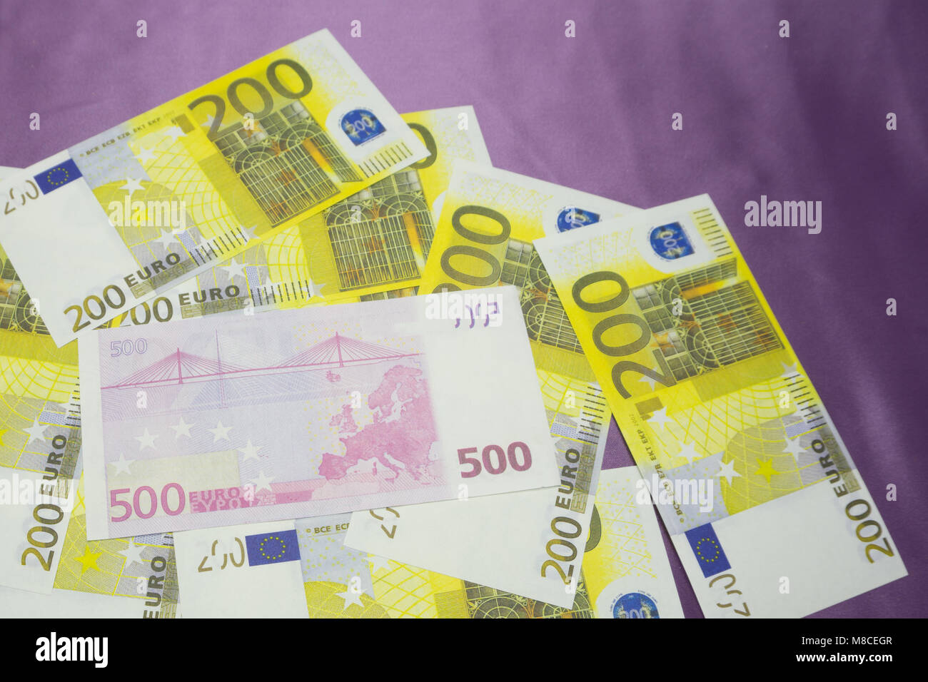 Various Euro banknotes of 200 and 500 Euro banknotes in a continuous layer Stock Photo