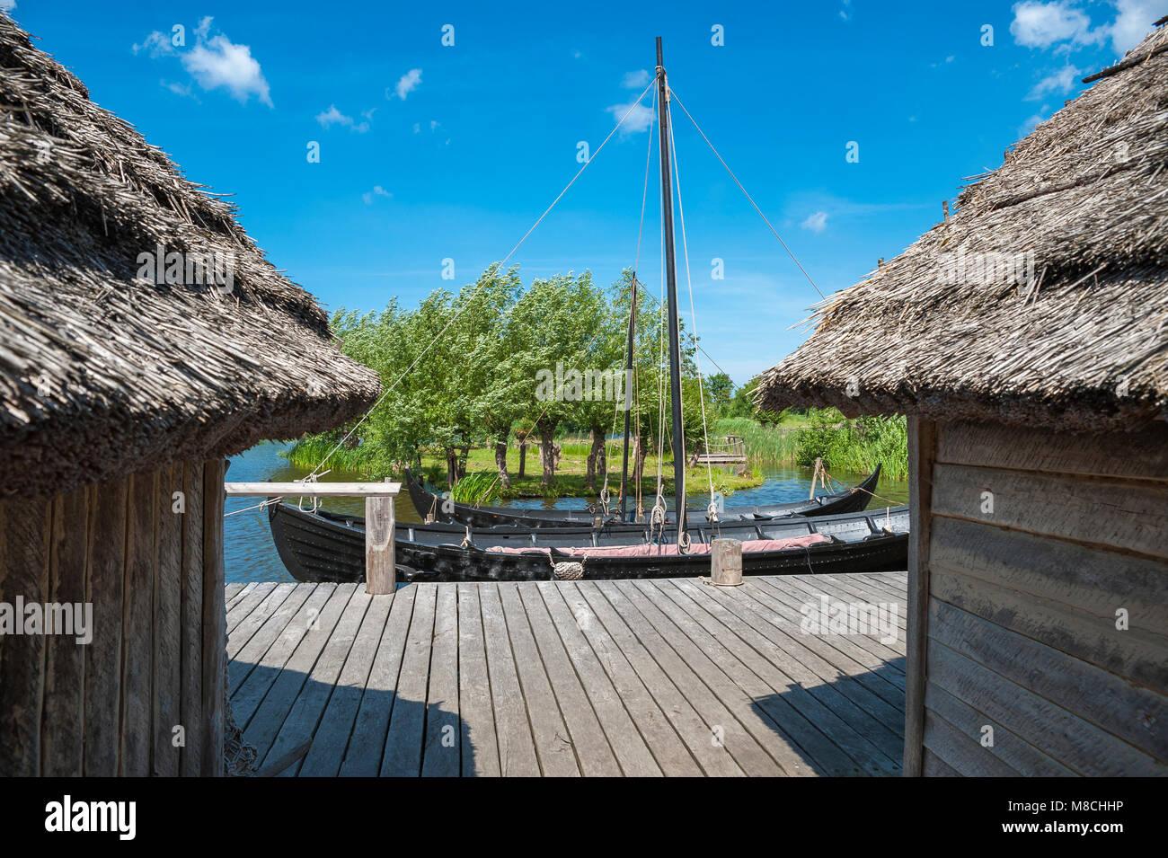 Wallmuseum, slavic village with a viking ship, slavic merchant-ship and dugout, Oldenburg in Holstein, Baltic Sea, - Stock Image