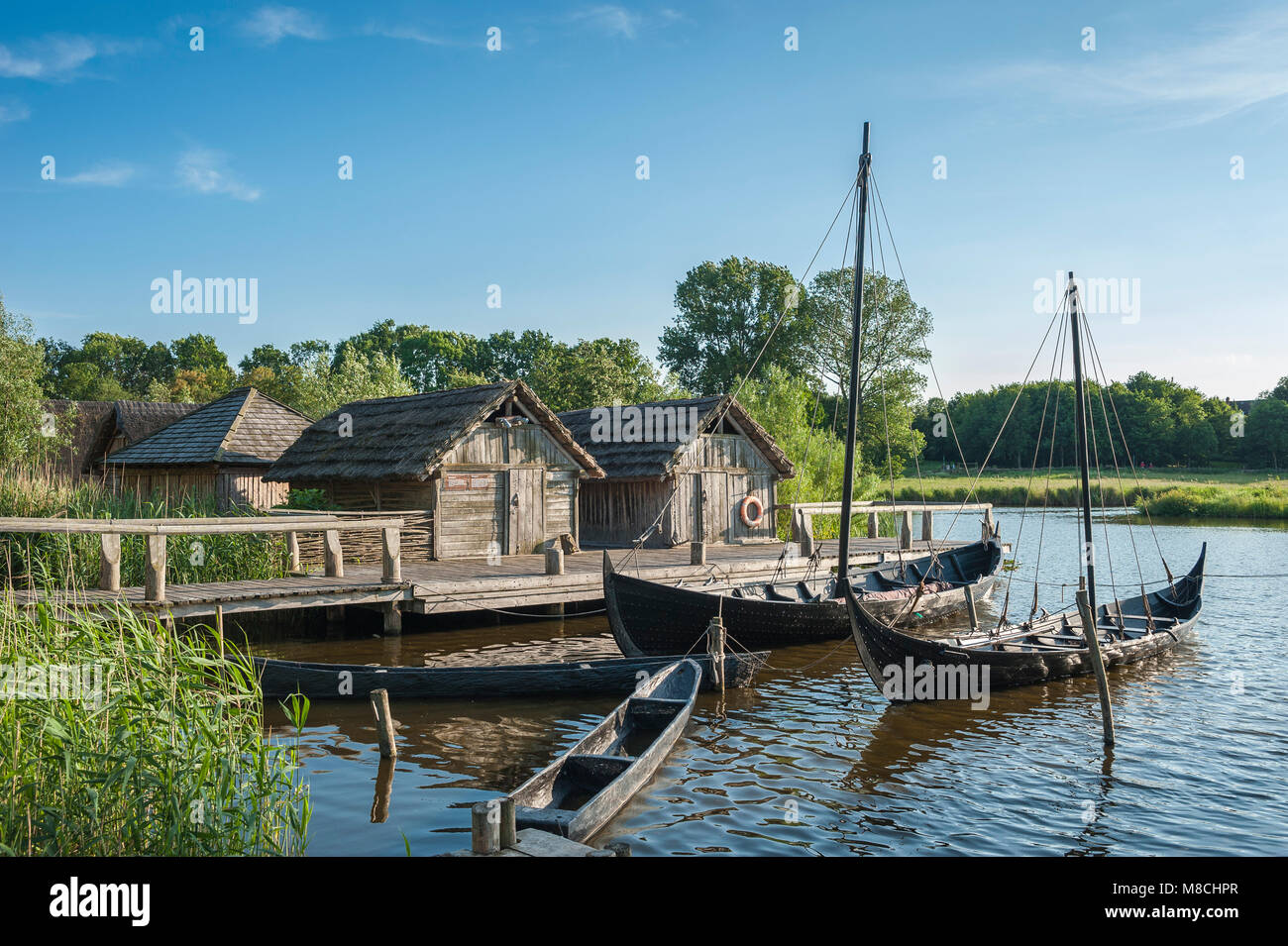 Wallmuseum, slavic village with a viking ship, slavic merchant-ship and dugout, Oldenburg in Holstein, Baltic Sea, - Stock Image