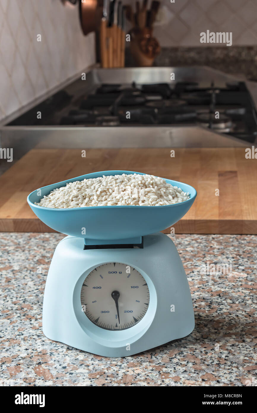 vintage blue kitchen scale on marble top 3 - Stock Image