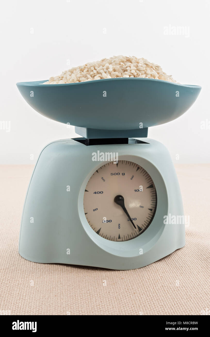 vintage kitchen blue scale on tablecloth - Stock Image