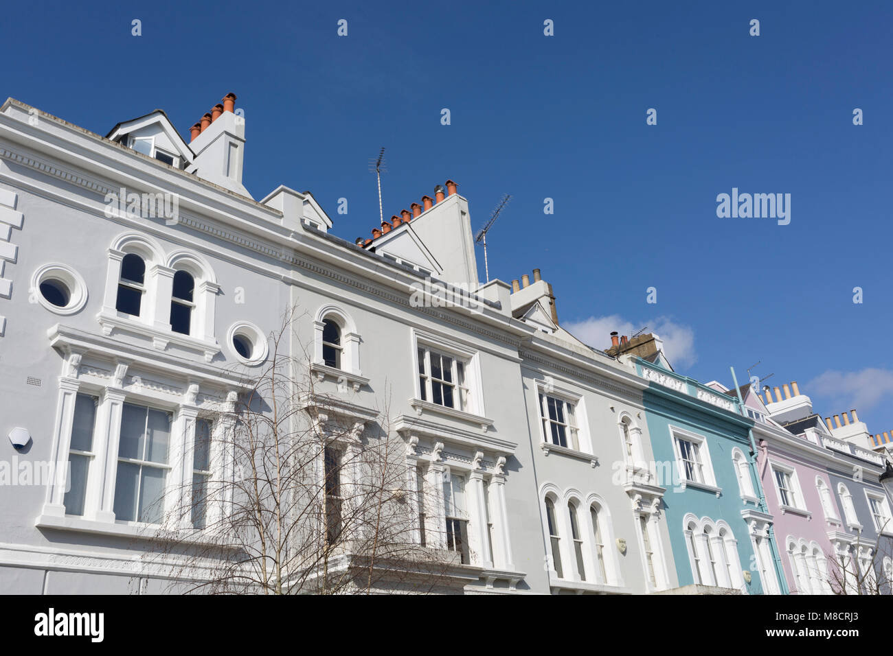 Victorian houses along Elgin Crescent W11 in Notting Hill, on 13th March 2018, in London, England. Elgin Crescent's Stock Photo