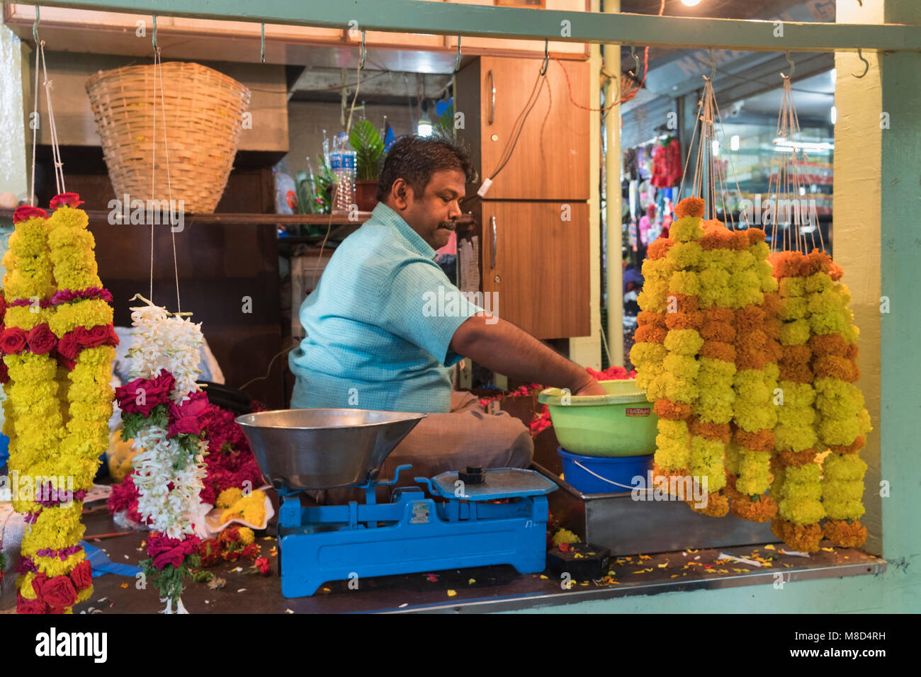 Margao market Flower garland maker Goa India - Stock Image