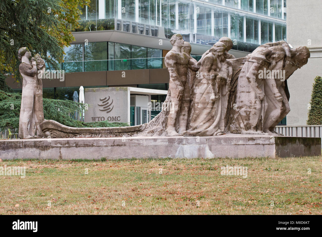 """Geneva: the headquarters of the World Trade Organization and the """"Human Effort"""" by James Vibert Stock Photo"""