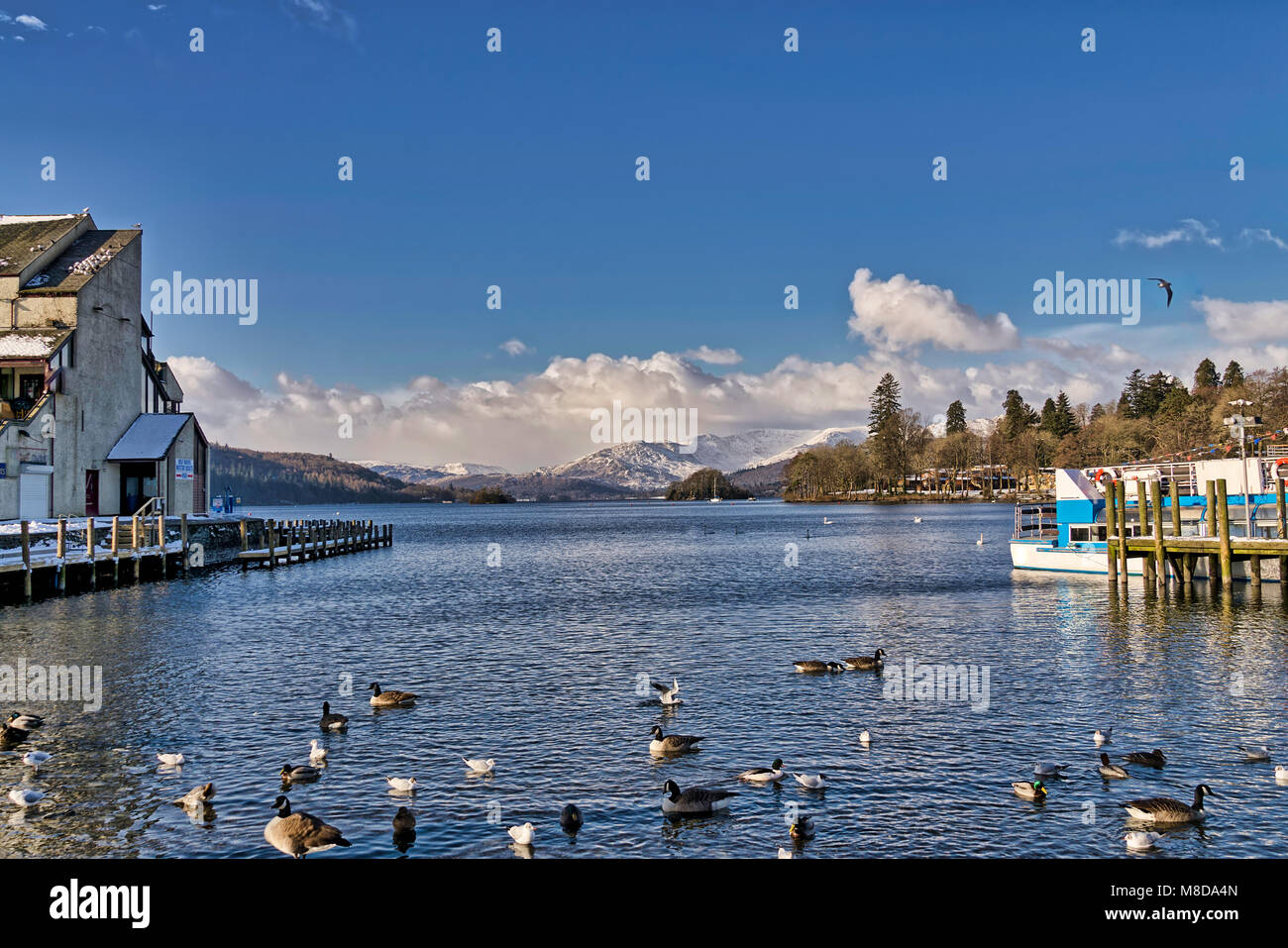 Bowness-on-Windermere with Fairfield on the horizon. - Stock Image