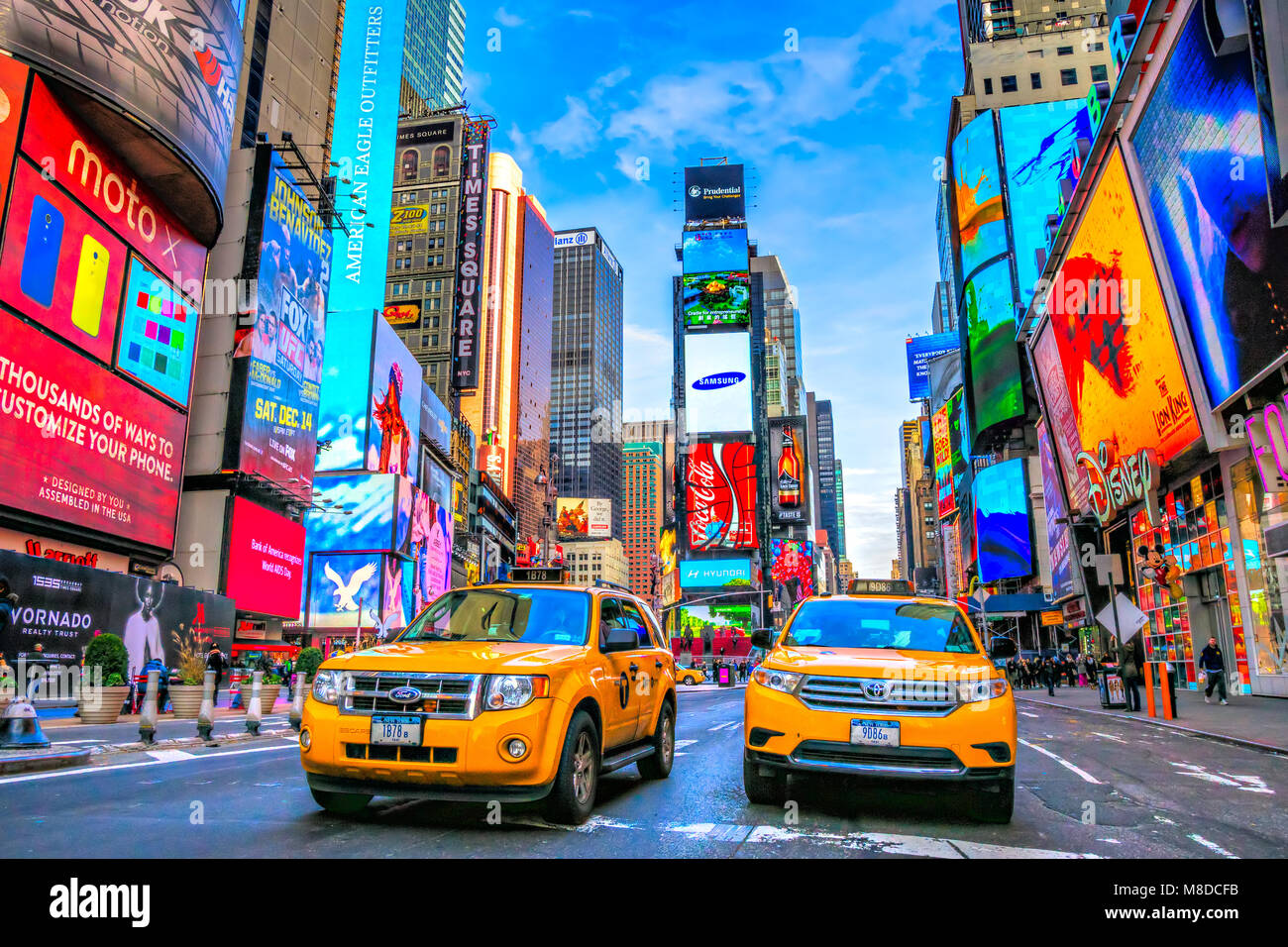 NEW YORK CITY, USA - DECEMBER 01, 2013: Times Square,is a busy tourist intersection of neon art and commerce and Stock Photo