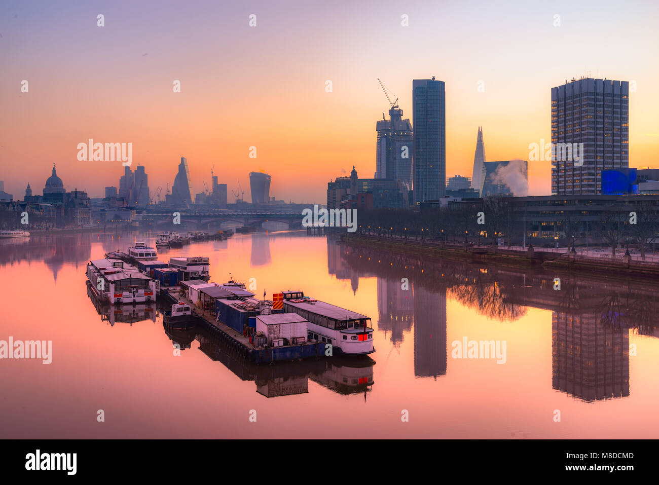 City of London skyline at sunrise with St. Paul basilica and modern skyscarpers, London, UK - Stock Image