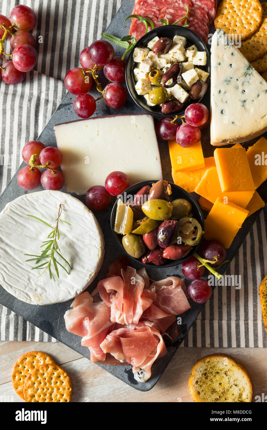 Gourmet Fancy Charcuterie Board with Meat Cheese and Grapes - Stock Image