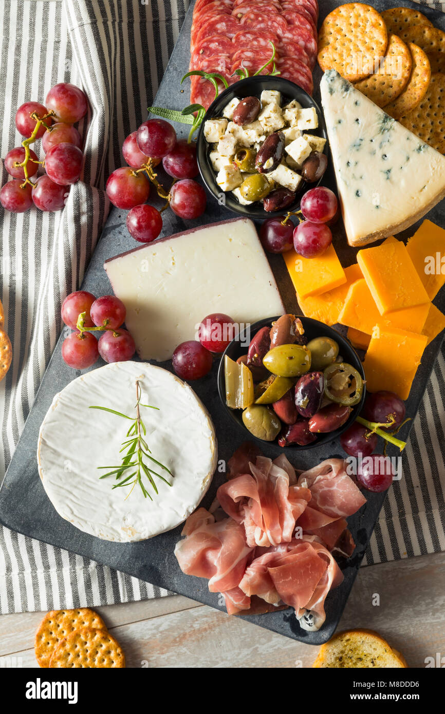 Gourmet Fancy Charcuterie Board with Meat Cheese and Grapes Stock Photo