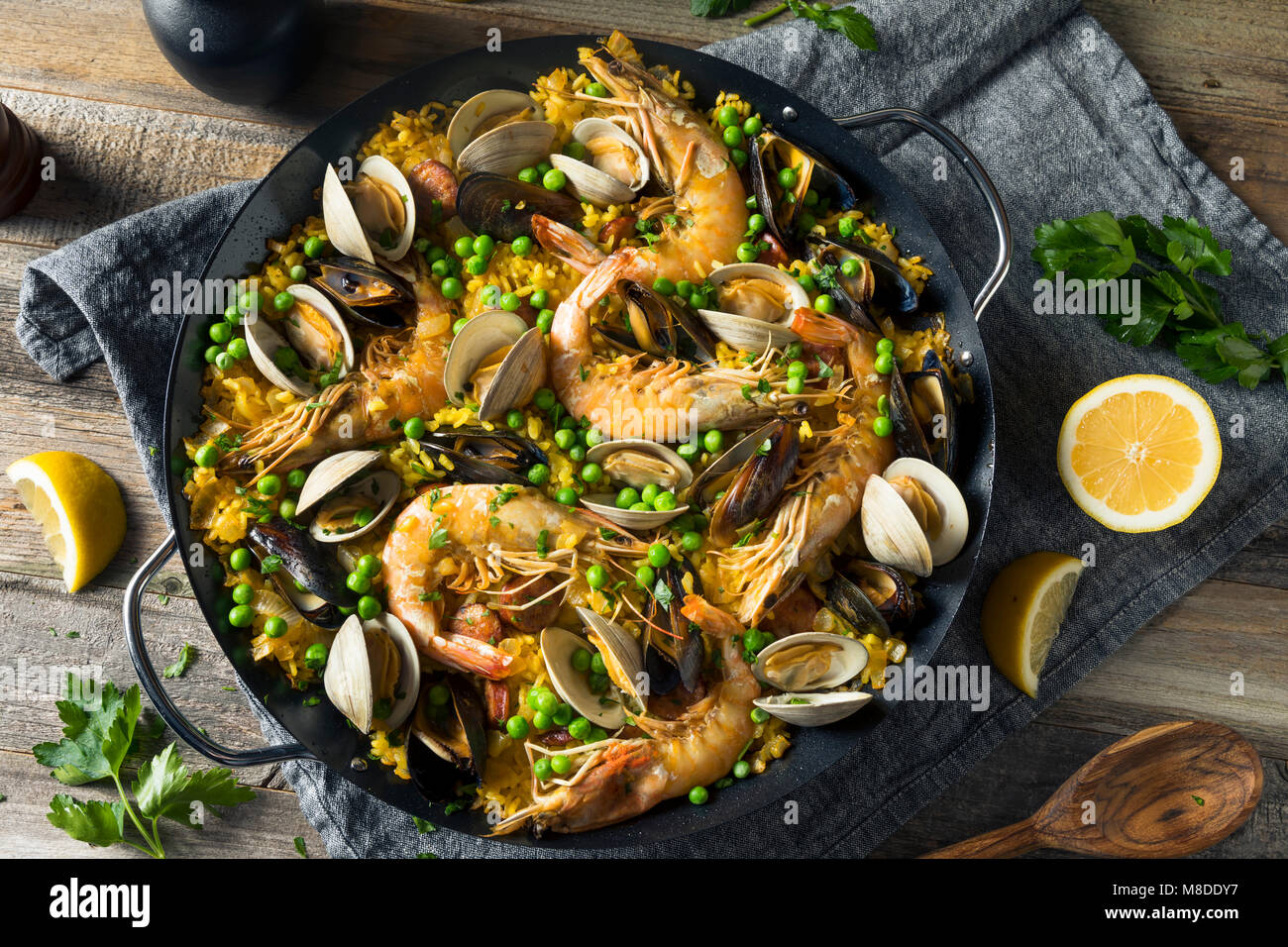 Homemade Spanish Seafood Paella with Prawns Mussels and Clams Stock Photo
