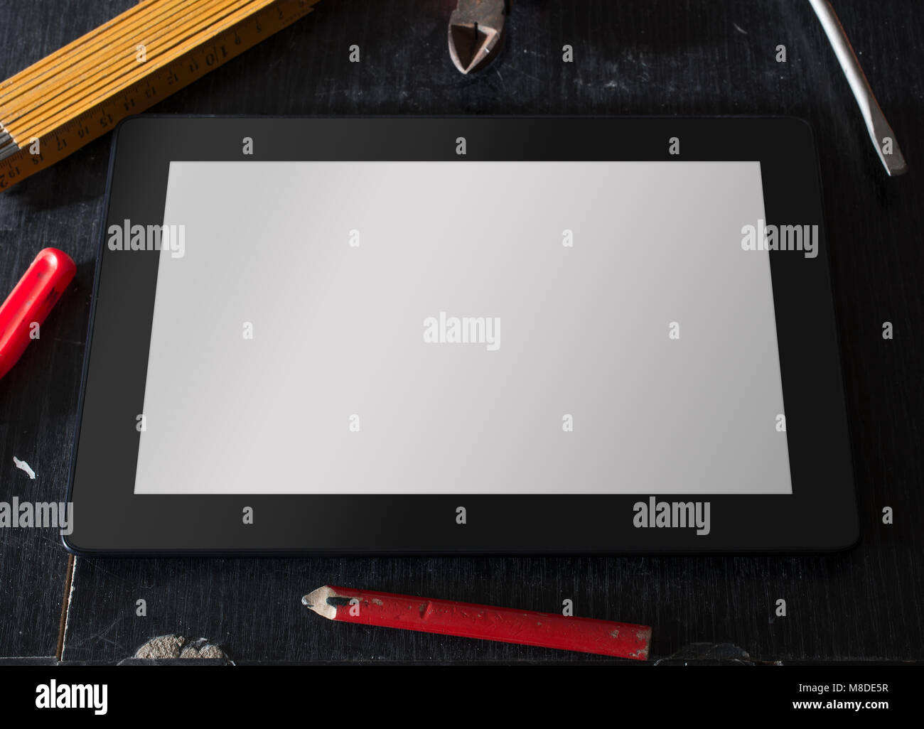 Tablet With Blank Screen Surrounded By Tools - Stock Image