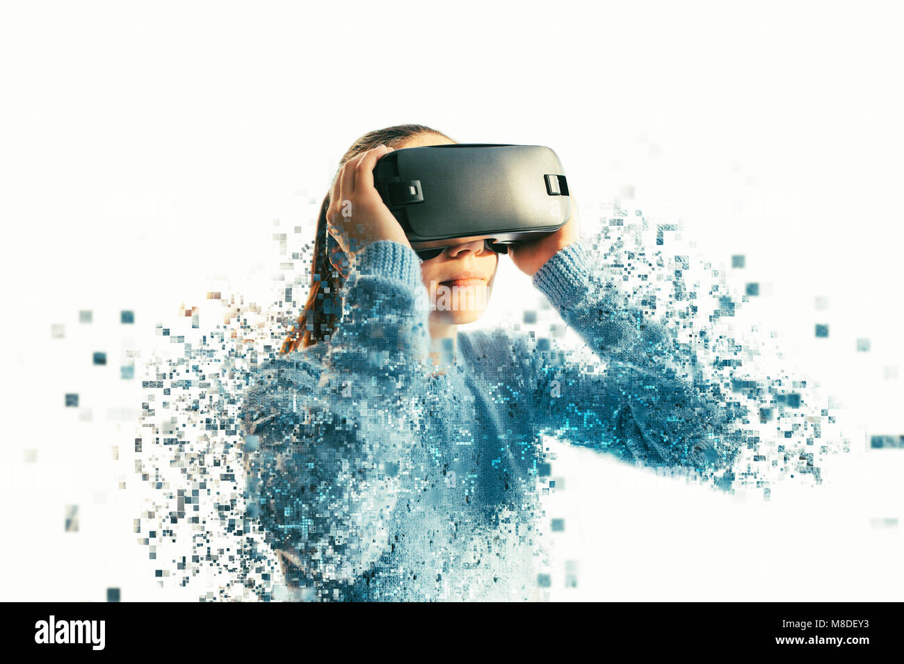 A person in virtual glasses flies to pixels. The woman with glasses of virtual reality. Future technology concept. - Stock Image