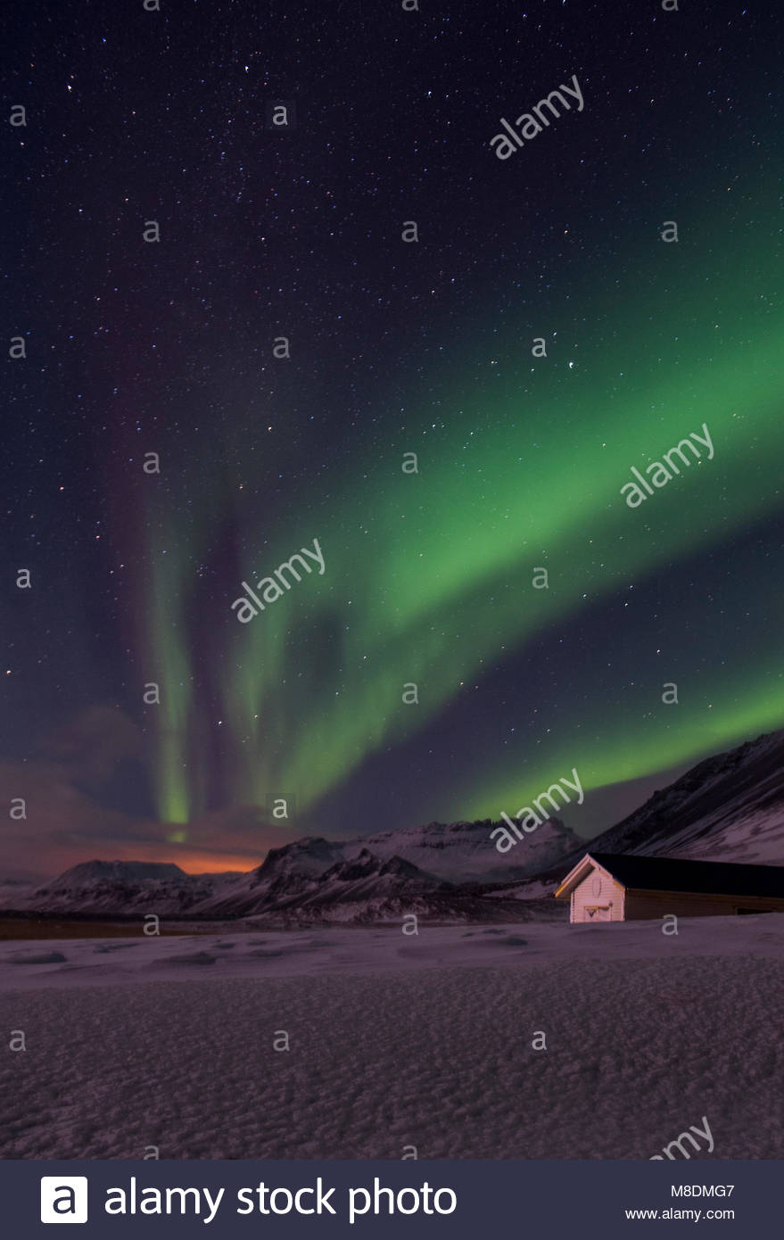 Aurora borealis over snow covered landscape, Snaefellsnes peninsula, Iceland, Europe - Stock Image