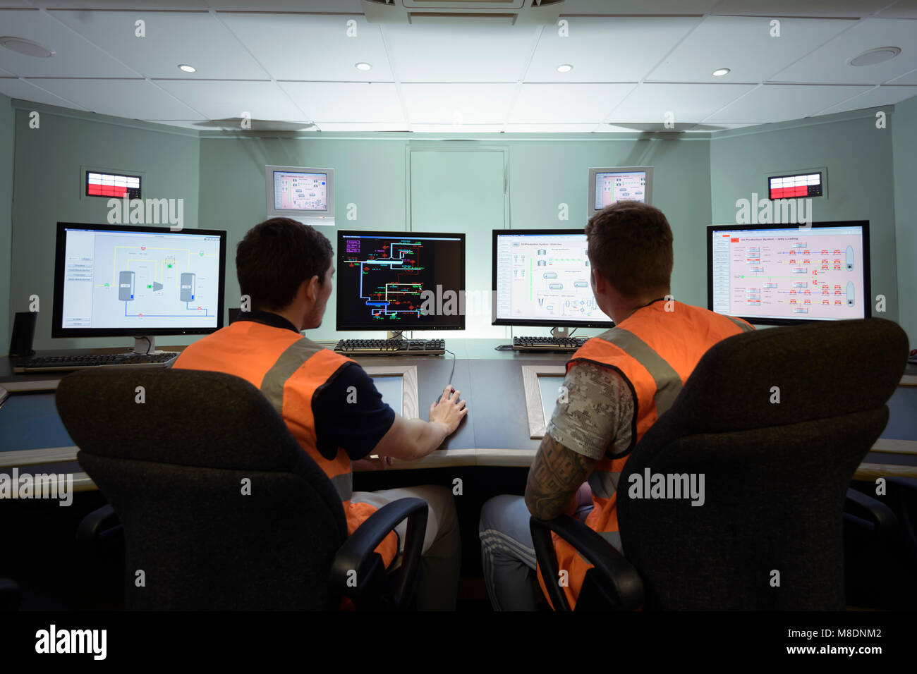 Apprentice engineers in industrial production facility training Stock Photo