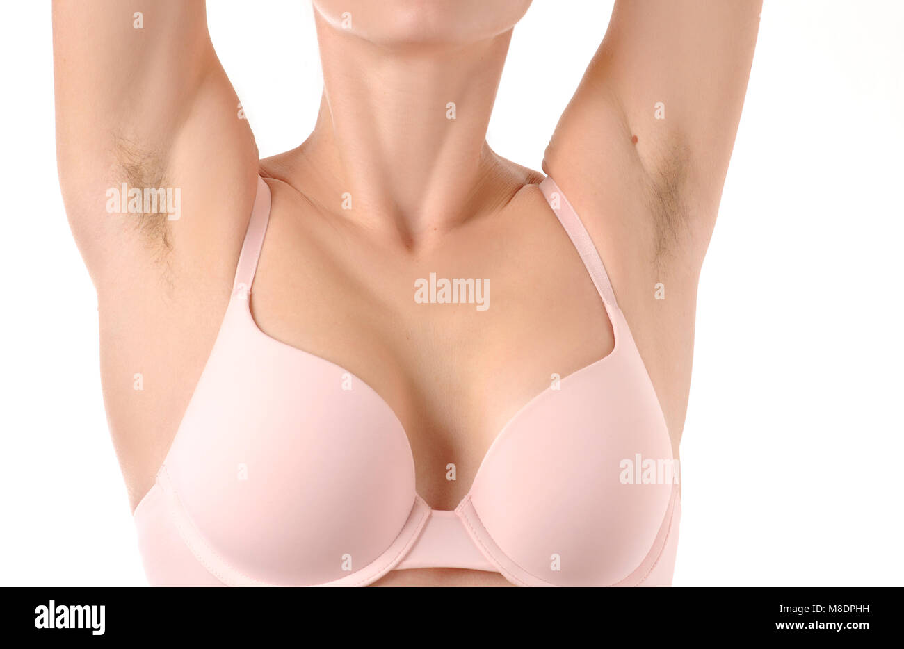 Female unshaved armpits. Woman with hairy armpits. Girl with long hair underarm - Stock Image