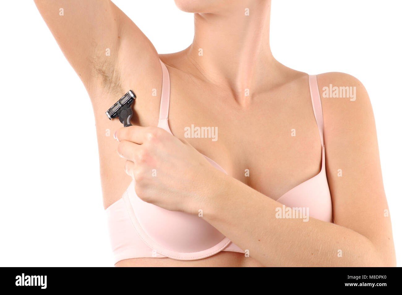 Woman shaving razor armpit on white background. Depilation, hair removal and skin care concept. - Stock Image