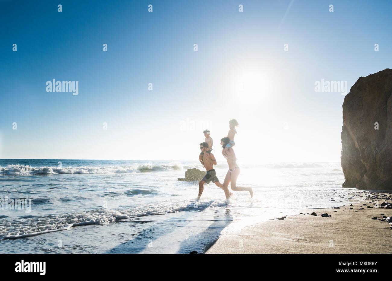 Family playing on El Matador Beach, Malibu, USA - Stock Image