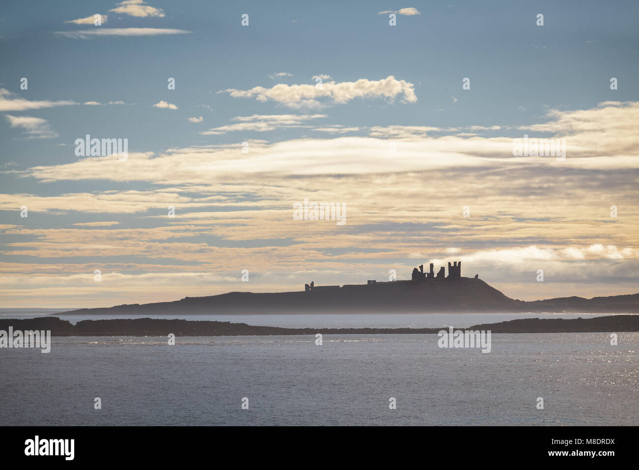 Dunstanburgh Castle from the Coastal Path, Northumberland - Stock Image