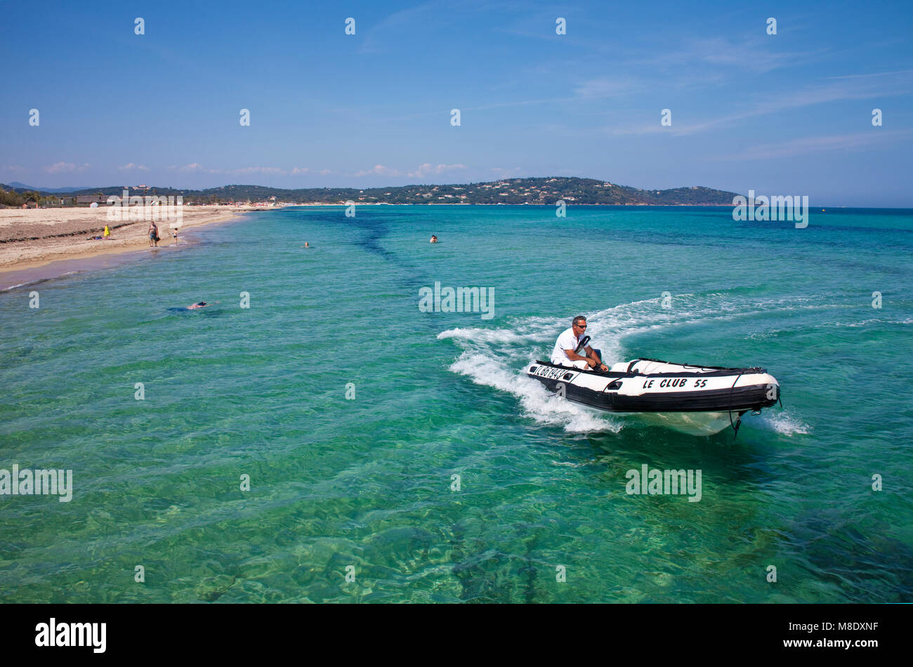 Inflatable dinghy cruising close Pampelonne beach, popular beach at Saint-Tropez, french riviera, South France, - Stock Image
