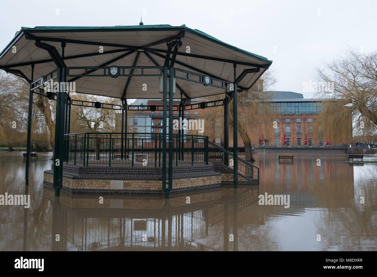 flooded town centre with bandstand completely surrounded by brown flood water from the river Avon - Stock Image