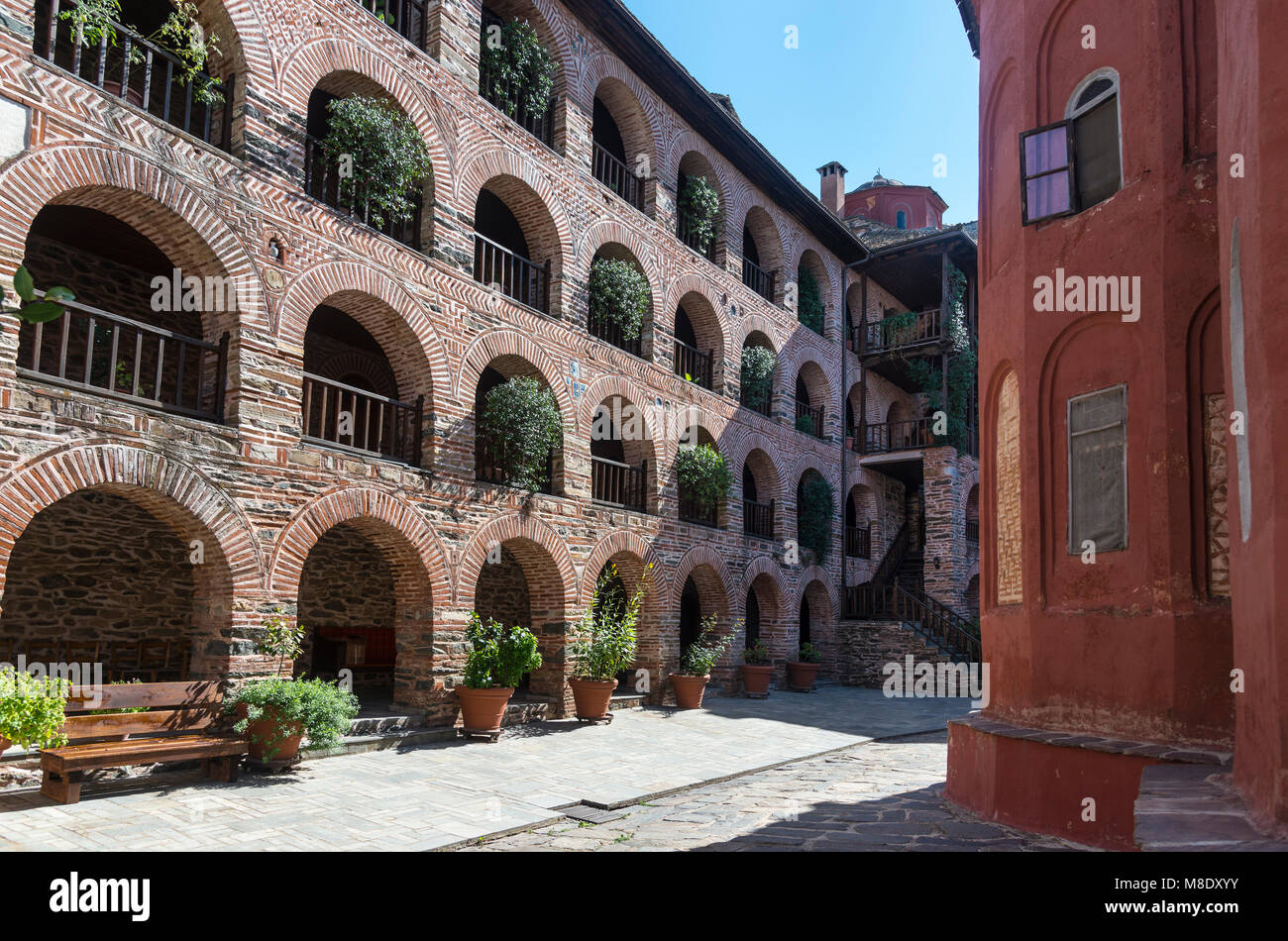 Monks cells in the inner courtyard of Koutloumousiou monastery  on The Athos peninsula, Macedonia, Northern Greece - Stock Image