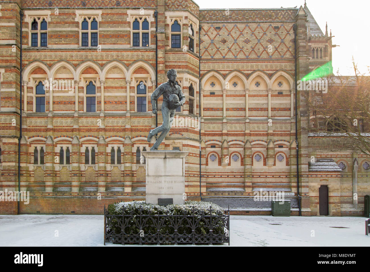 The statue of a young William Webb Ellis who invented Rugby outside Rugby School in the town centre of Rugby. - Stock Image