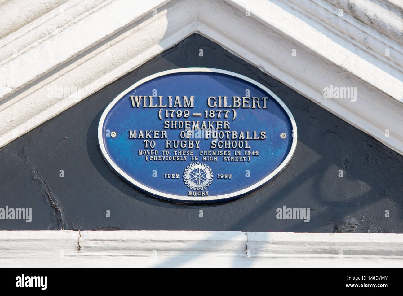 The sign above the Webb Ellis Museum in Rugby honouring the rugby Football shoe maker  William Gilbert. - Stock Image