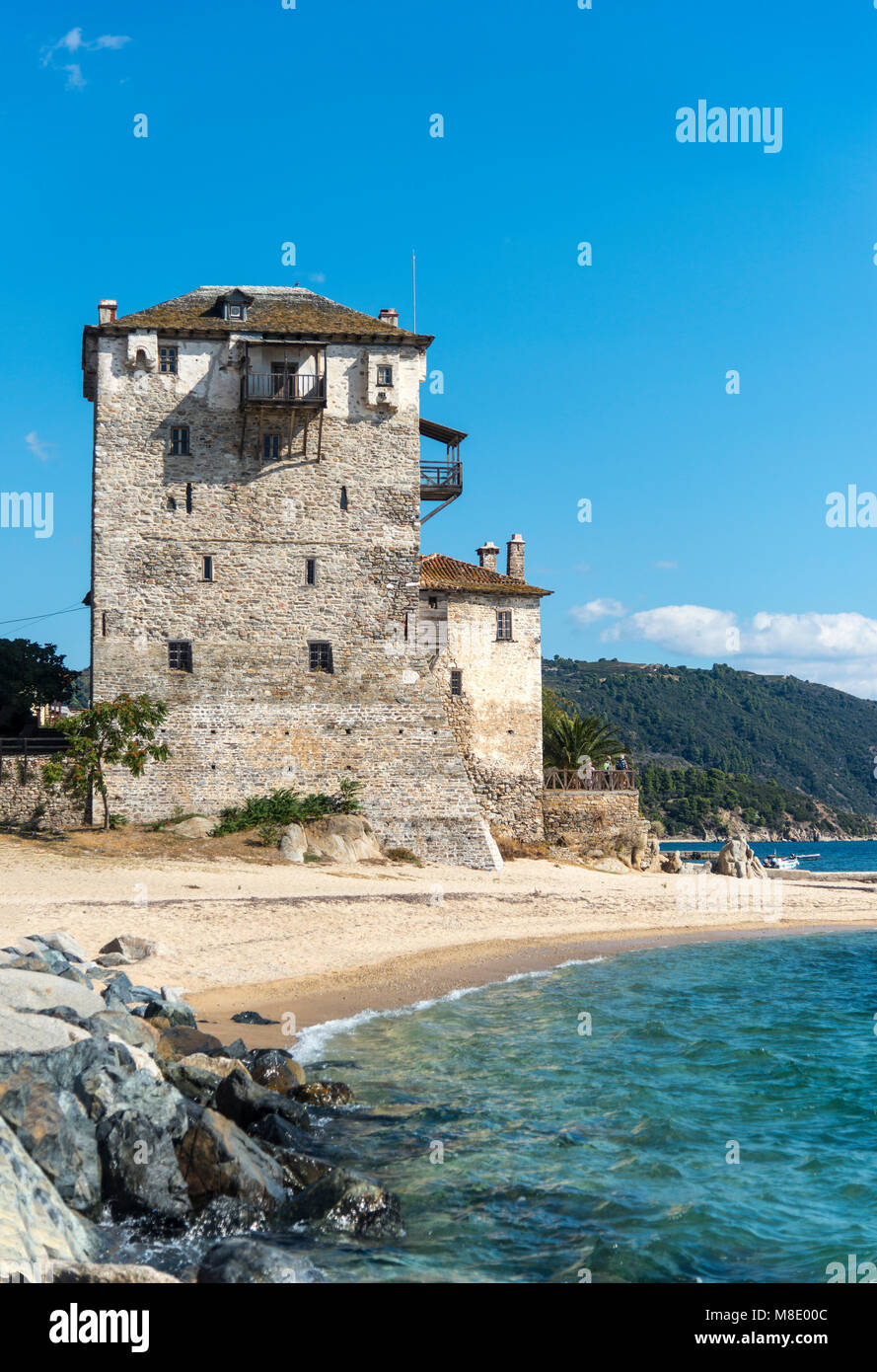 The Prosphorios tower, on the beach at Ouranoupoli with the Athos Peninsula in the background.   Chalkidiki, Macedonia, - Stock Image