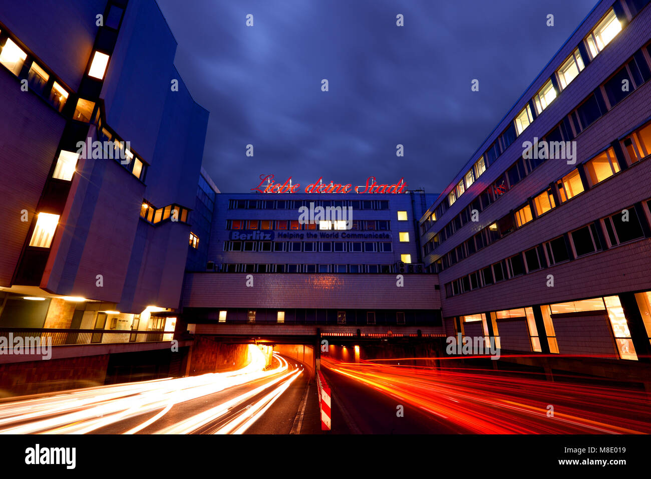 North-South throughway in Cologne, Germany, at night. Neon sign 'Liebe deine Stadt' ('Love your city') - Stock Image
