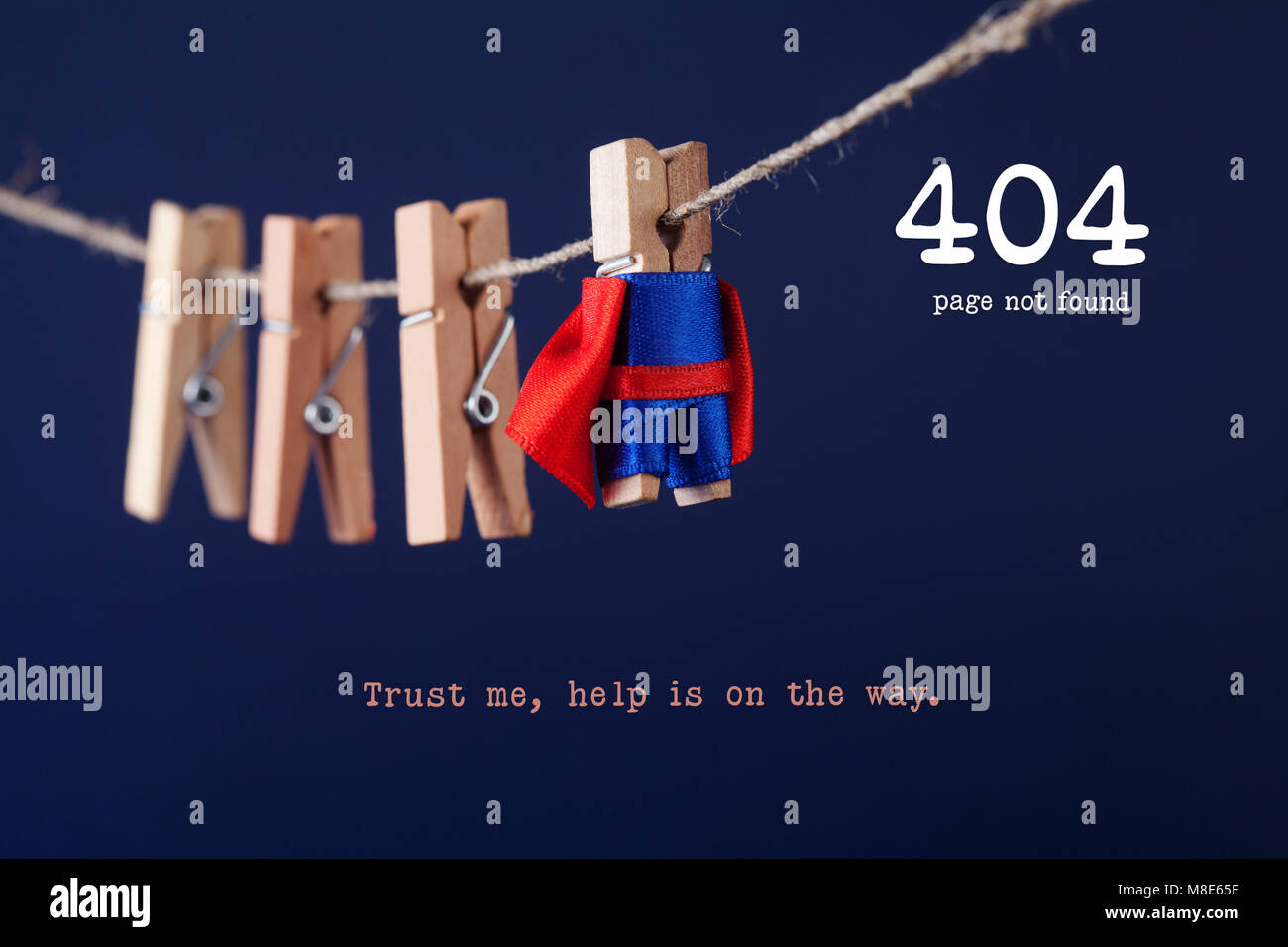Error 404 page not found web page. Toy clothespin peg superhero on clothesline, blue background. Trust me help is - Stock Image
