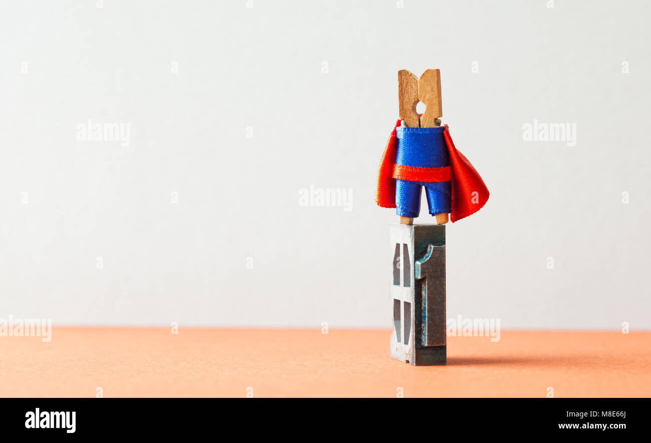 Champion superstar hero winner first place. Successful leadership conceptual photography. Brave wooden clothespin - Stock Image