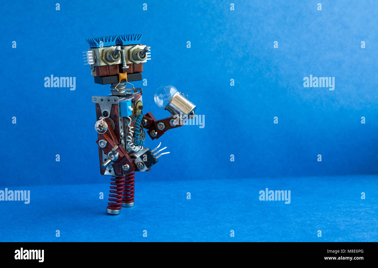 Futuristic robot concept. Friendly cyborg character funny head, big eyes, light bulb in hand. Copy space, blue background - Stock Image