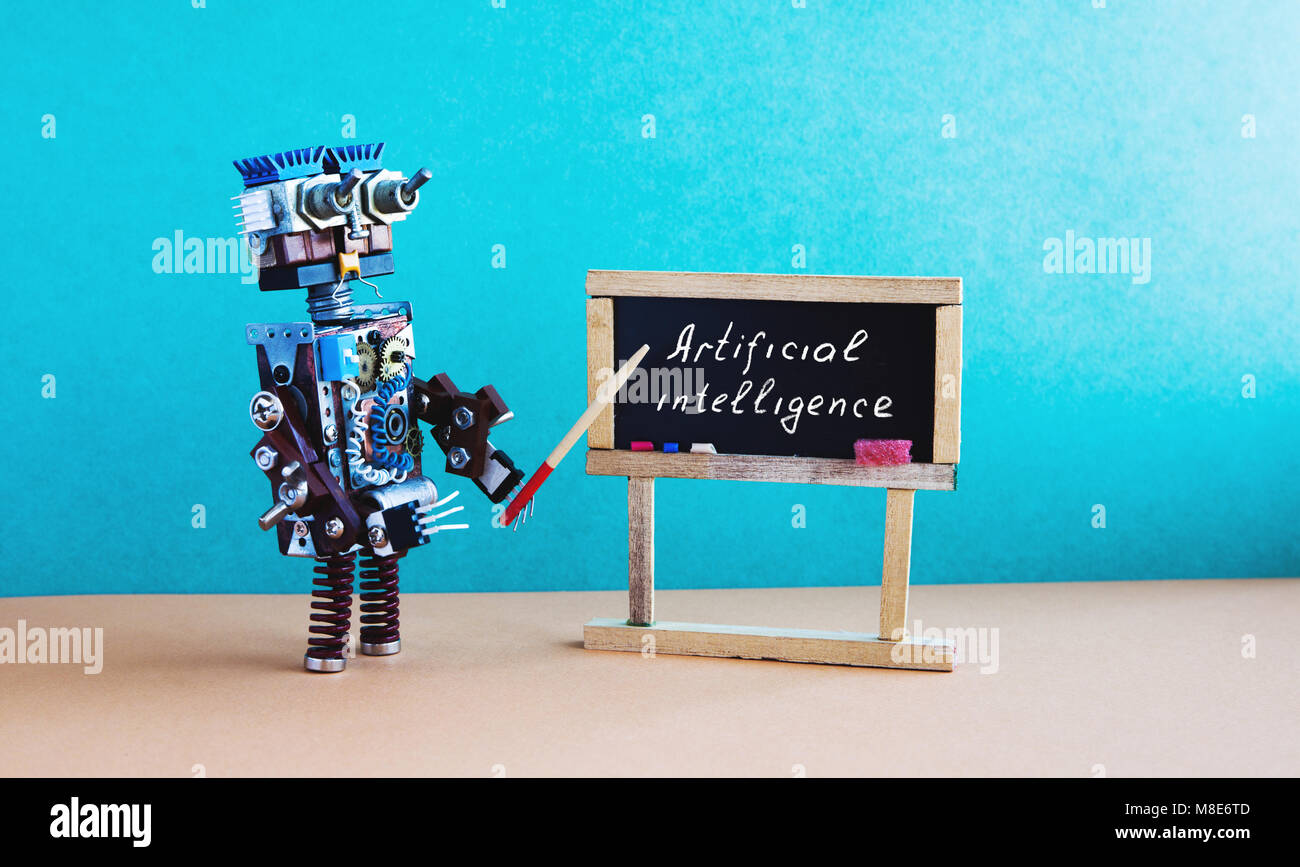 Artificial intelligence concept. Robot teacher explains modern theory. Classroom interior with handwritten quote - Stock Image