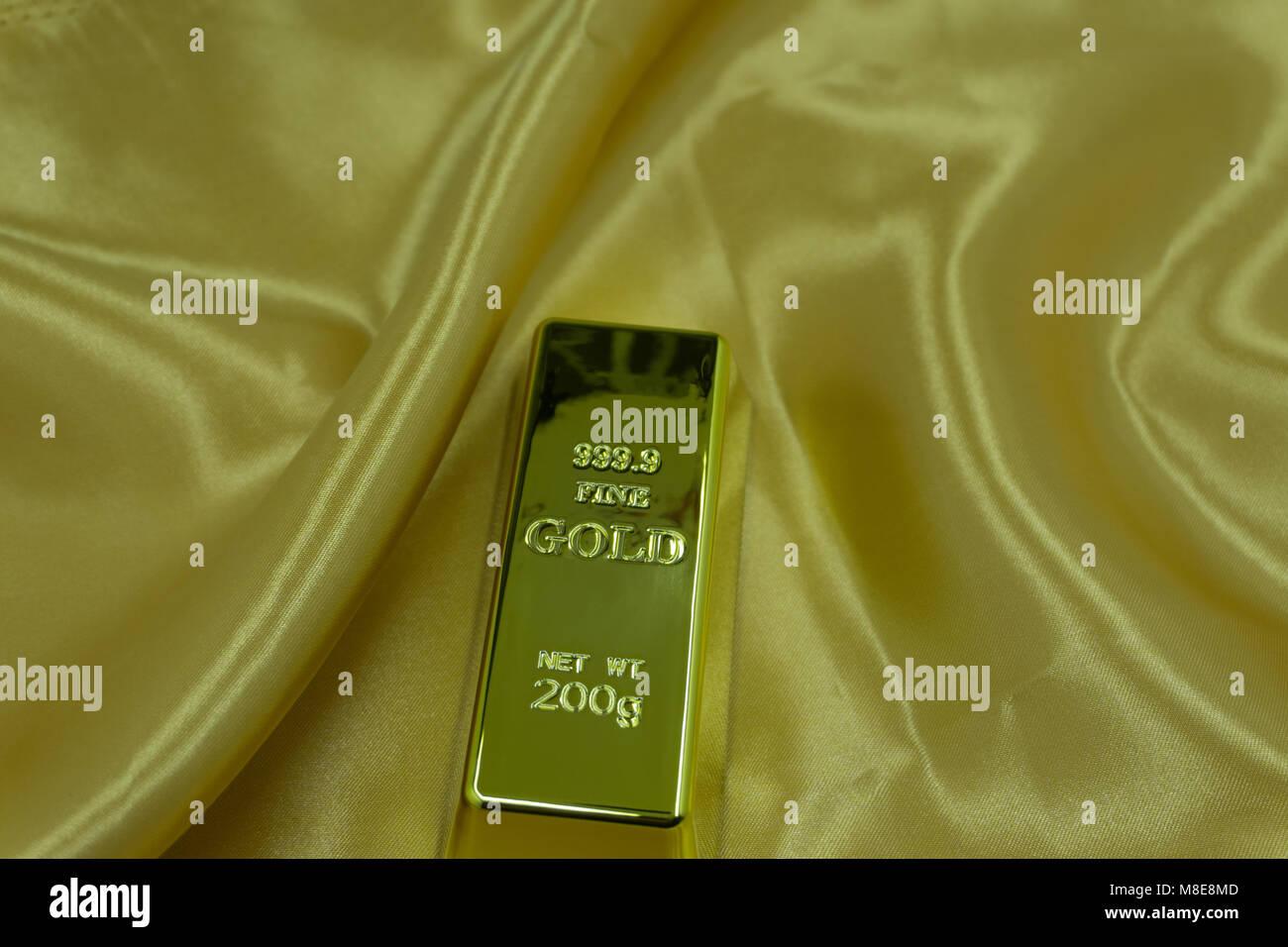 gold on a gold ingot , - Stock Image